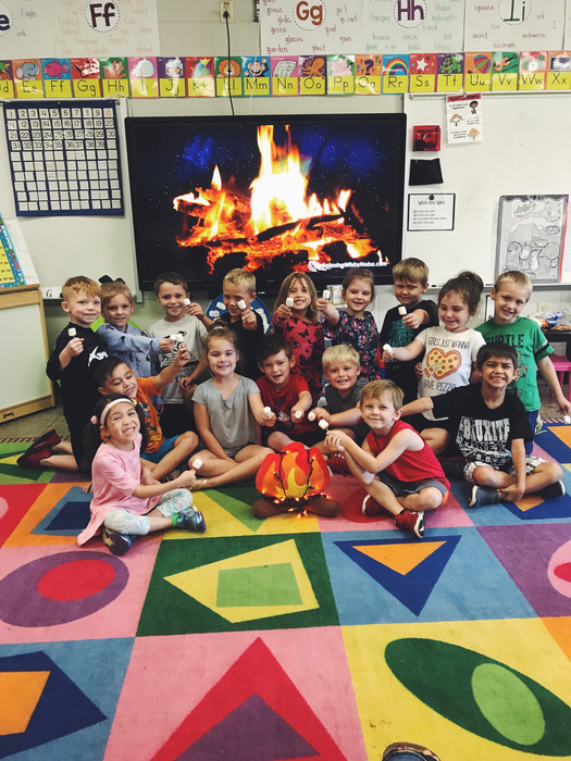 Kindergarten students hanging around the fire!