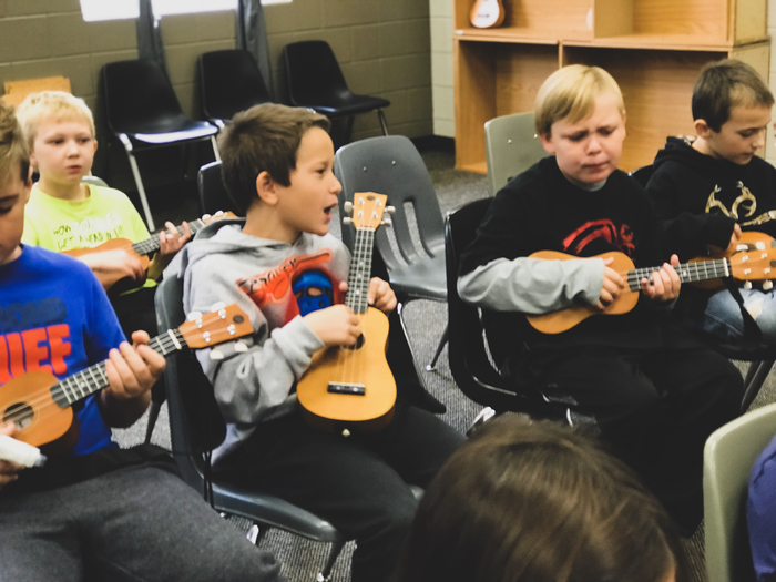 3rd Grade students in their ukulele feelings.
