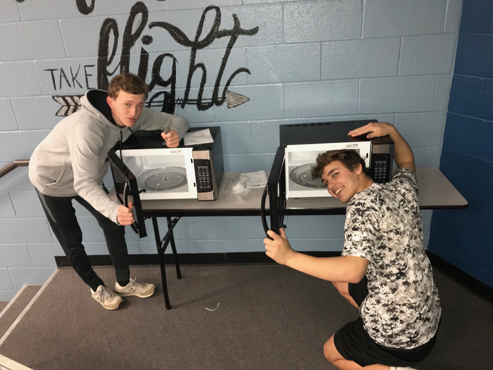 Student Council donates microwave.